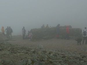 Misty and busy on the Summit of Helvellyn