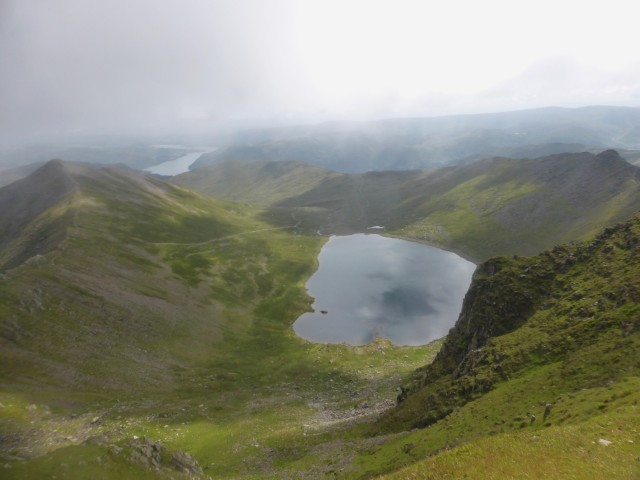 Catstycam, Red Tarn and Striding Edge from Helvellyn Summit with Ullswater behind